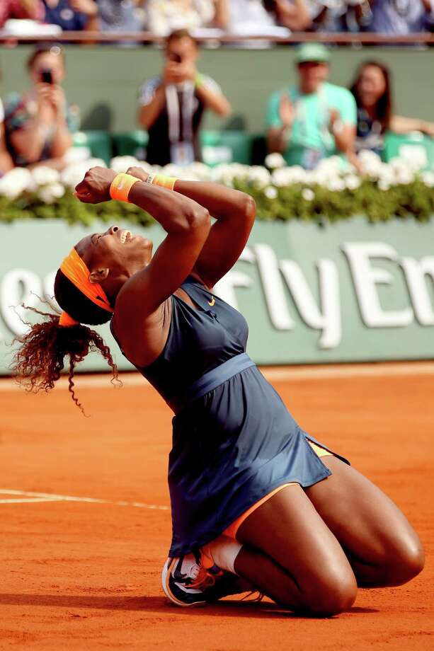 PARIS, FRANCE - JUNE 08:  Serena Williams of United States of America celebrates match point in her Women's Singles Final match against Maria Sharapova of Russia  during day fourteen of French Open at Roland Garros on June 8, 2013 in Paris, France.  (Photo by Matthew Stockman/Getty Images) Photo: Matthew Stockman