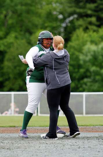 Greenwich senior Jasmine James hugs assistant Coach Tomarra McCall after hitting a double during the