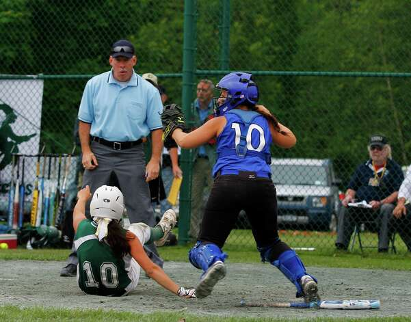 Greenwich senior pitcher Sarah Heimbach, 10, slides past Sandy Creek catcher Viktoria White, 10, during the Class c semi final game, Saturday, June 8, 2013 at the Adirondack Sport Complex in Queensbury, N.Y. (Dan Little/Special to the Times Union) Photo: Dan Little / Dan Little
