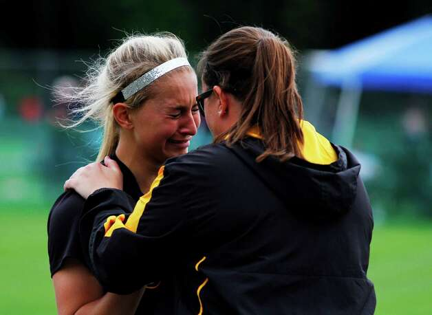 Troy High assistant Coach Tara Anthony, right, consoles pitcher Hunter Levesque after a 6-4 loss to Sayville for the Class A state semifinal game, Saturday, June 6 at the Adirondack Sport Complex in Queensbury, N.Y. (Dan Little/Special to the Times Union) Photo: Dan Little / Dan Little