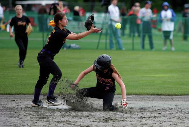 Troy High second basemen Alina Germinerio, 16, attempts to tag out Sayvilles Lyndsey Shaw, 2, during the Class A state semifinal game, Saturday, June 8, 2013 at the Adirondack Sport Complex in Queensbury, N.Y. (Dan Little/Special to the Times Union) Photo: Dan Little / Dan Little