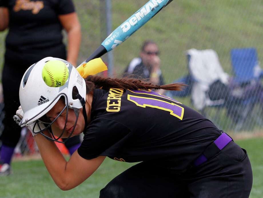 Troy High Sophmore Alina Germinerio, 16, is hit by a pitch during the Class A state semifinal game against Sayville, Saturday, June 8, 2013 at the Adirondack Sport Complex in Queensbury, N.Y. (Dan Little/Special to the Times Union) Photo: Dan Little / Dan Little