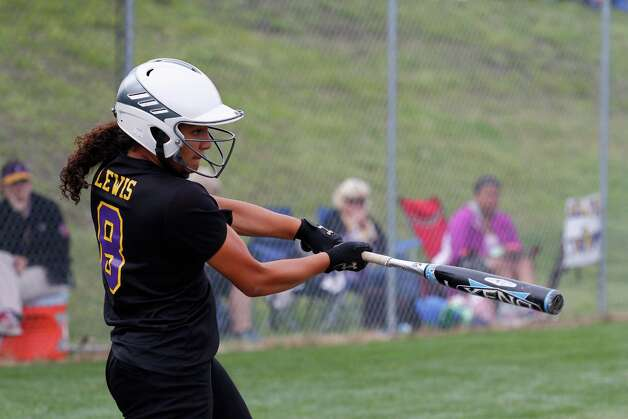 Troy High Freshman Lexi Lewis, 8, swings for a homerun during the Class A state semifinal game against Sayville, Saturday, June 8, 2013 at the Adirondack Sport Complex in Queensbury, N.Y. (Dan Little/Special to the Times Union) Photo: Dan Little / Dan Little