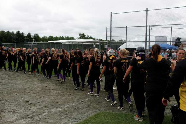 Troy High girls line up to shake hands after losing their Class A state semifinal game against Sayville 6-4, Saturday, June 8, 2013 at the Adirondack Sport Complex in Queensbury, N.Y. (Dan Little/Special to the Times Union) Photo: Dan Little / Dan Little