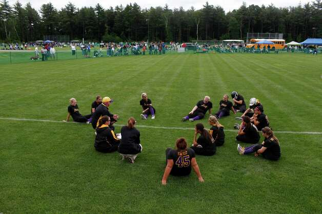 Head Coach George Rafferty talks to the Troy High girls after losing their Class A state semifinal game against Sayville 6-4, Saturday, June 8, 2013 at the Adirondack Sport Complex in Queensbury, N.Y. (Dan Little/Special to the Times Union) Photo: Dan Little / Dan Little