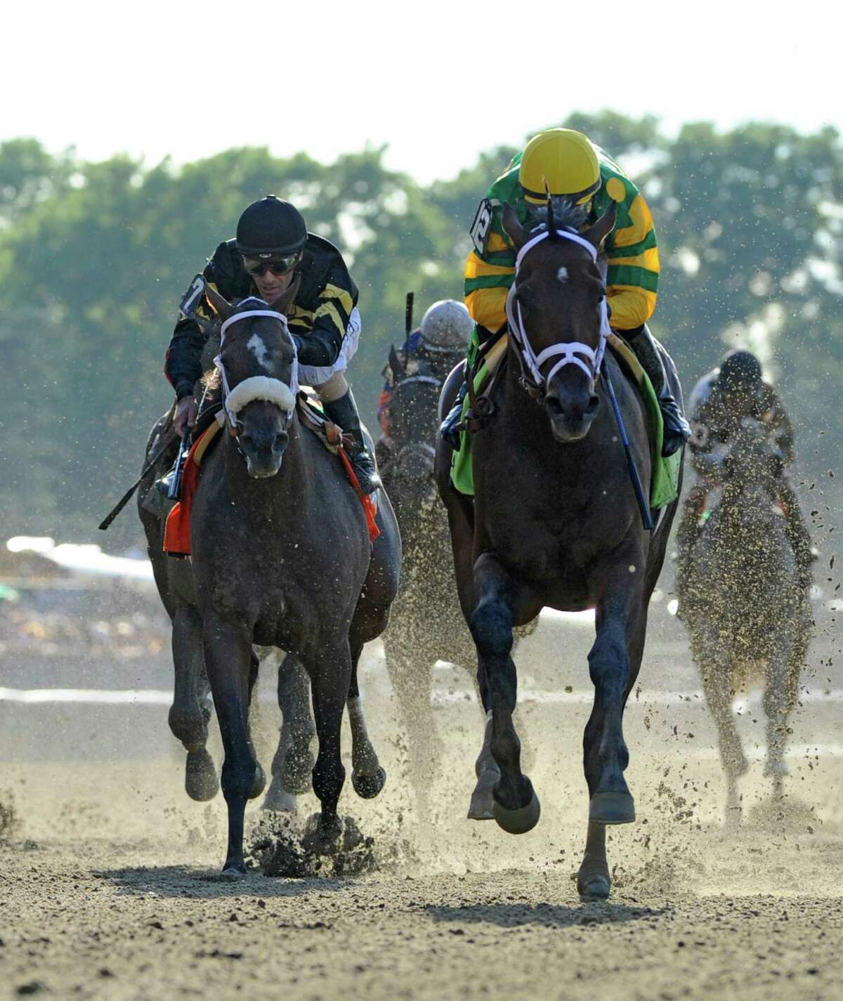 Jockey Mike Smith guides Palace Malice, right, to the win in the 145th running of The Belmont Stakes June 8, 2013 at Belmont Park in Elmont, N.Y. Second place went to Oxbow with jockey Gary Stevens aboard, left. (Skip Dickstein/Times Union)