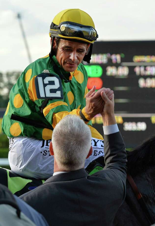 Jockey Mike Smith gets a congratulatory hand shake from trainer Todd Pletcher after winning the 145th running of The Belmont Stakes on Palace Malice June 8, 2013 at Belmont Park in Elmont, N.Y.  (Skip Dickstein/Times Union) Photo: SKIP DICKSTEIN