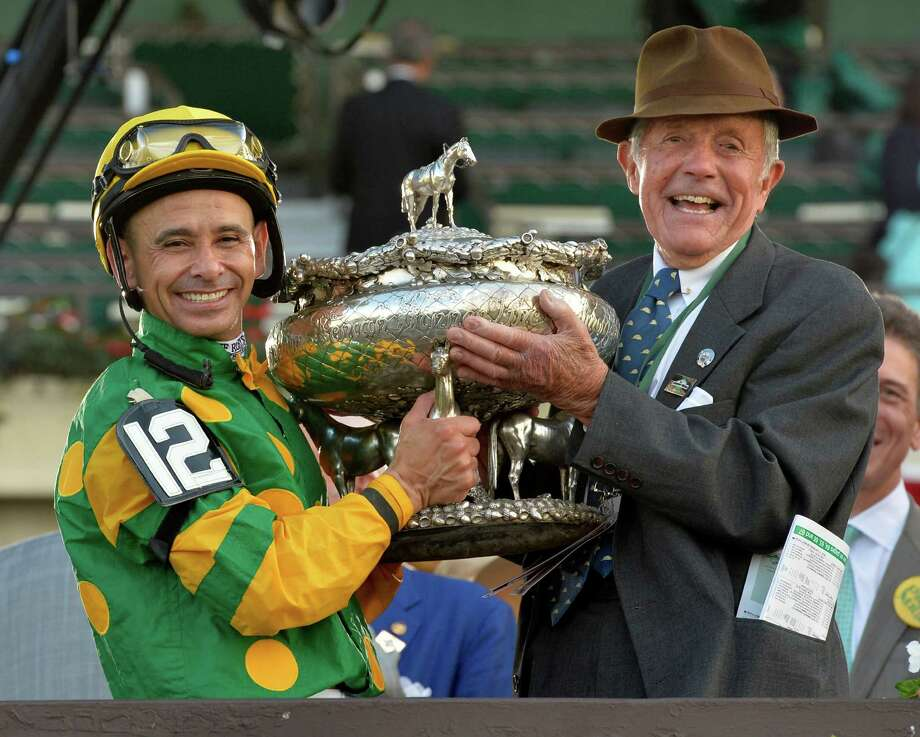 Jockey Mike Smith, left and owner Cot Campbell hold the winner's trophy after Palace Malice won the 145th running of The Belmont Stakes June 8, 2013 at Belmont Park in Elmont, N.Y.  (Skip Dickstein/Times Union) Photo: SKIP DICKSTEIN