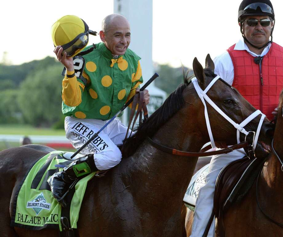 Jockey Mike Smith is exultant aboard Palace Malice after winning the 145th running of The Belmont Stakes June 8, 2013 at Belmont Park in Elmont, N.Y.  (Skip Dickstein/Times Union) Photo: SKIP DICKSTEIN