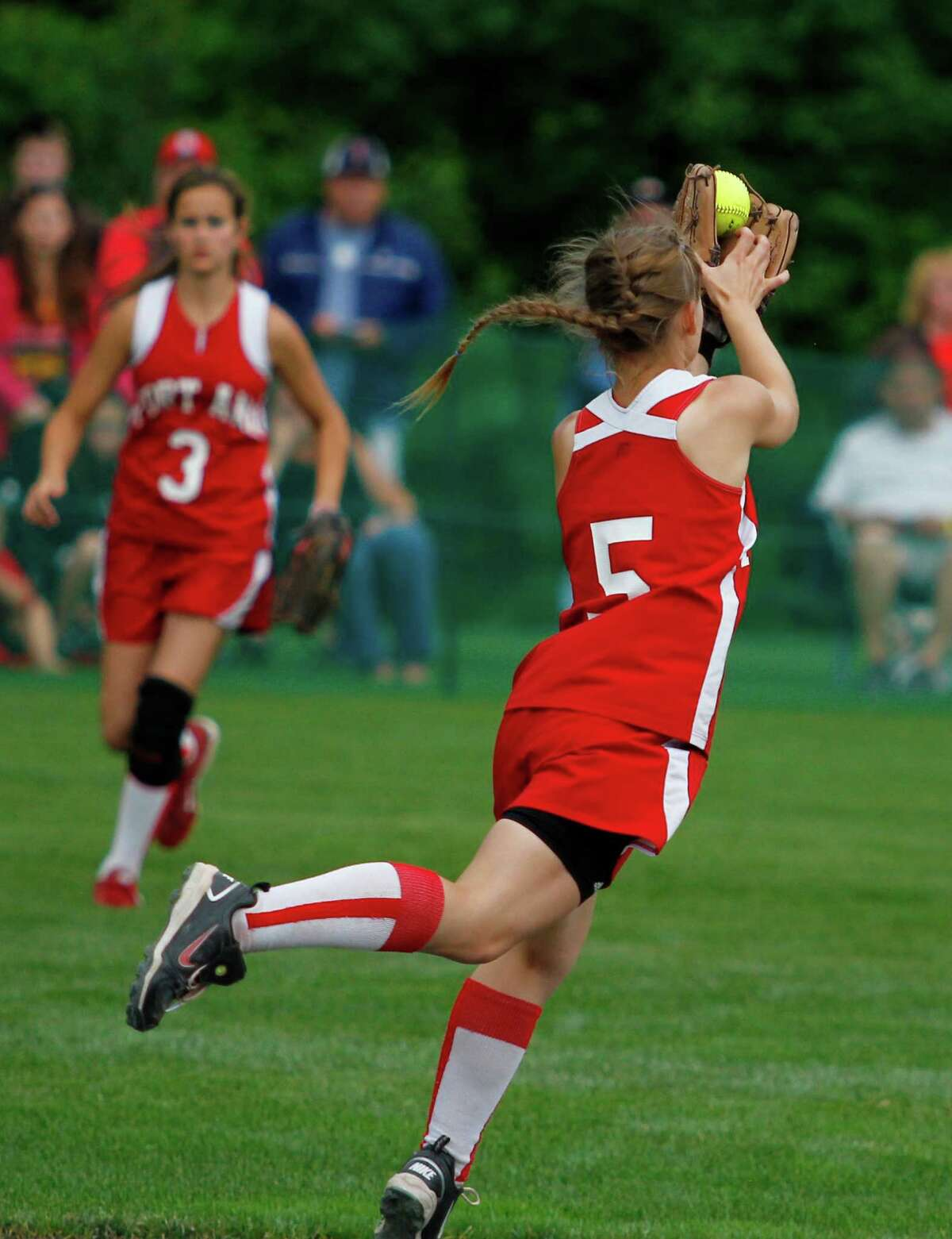 Fort Ann Junior second baseman Kimmi Ostrander, 5, makes an over the shoulder jumping catch during the Class D state championship game against Afton, Saturday, June 8, 2013 at the Adirondack Sport Complex in Queensbury, N.Y. (Dan Little/Special to the Times Union)