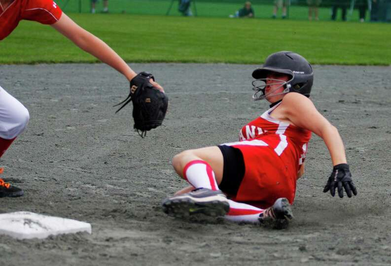 Fort Ann Junior Kaleigh Foran, 14, slides into third base during the Class D state championship game