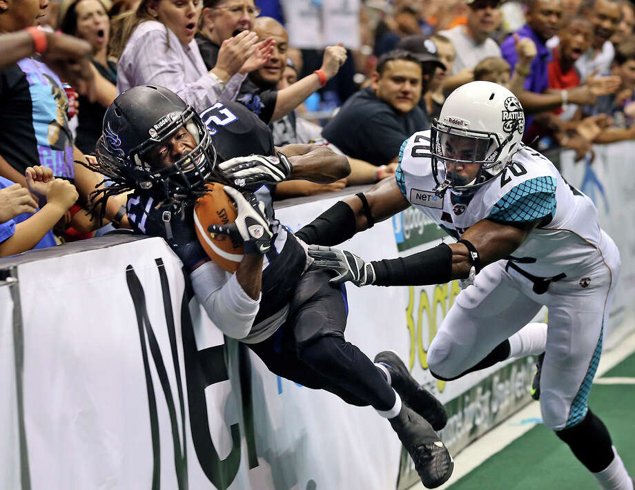 San Antonio receiver Brent Holmes crashes into the sideline inside the five yard line after a catch against defender Jeremy Kellem setting up the only home team score in the first half as the Talons host the Arizona Rattlers in the Alamodome on June 8, 2013. Photo: Tom Reel, San Antonio Express-News