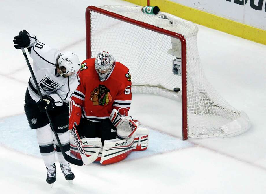 The Kings' Mike Richards scores against Blackhawks goalie Corey Crawford in the closing seconds. Photo: Charles Rex Arbogast, STF / ap
