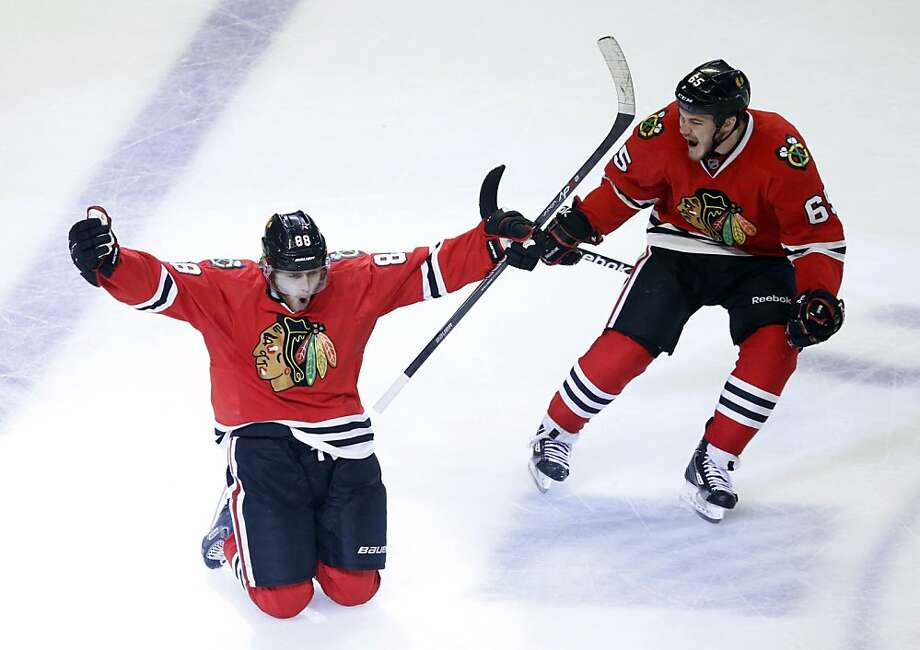Chicago Blackhawks right wing Patrick Kane (88) celebrates his goal with center Andrew Shaw (65) during the second overtime period in Game 5 of the NHL hockey Stanley Cup playoffs Western Conference finals against the Los Angeles Kings, Saturday, June 8, 2013, in Chicago. The Blackhawks won 4-3 and advanced to the Stanley Cup finals. (AP Photo/Charles Rex Arbogast) Photo: Charles Rex Arbogast, Associated Press