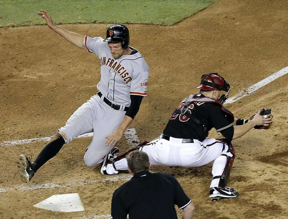 Hunter Pence scores as Miguel Montero waits for the throw during the Giants' six-run fourth inning. Photo: Matt York, Associated Press