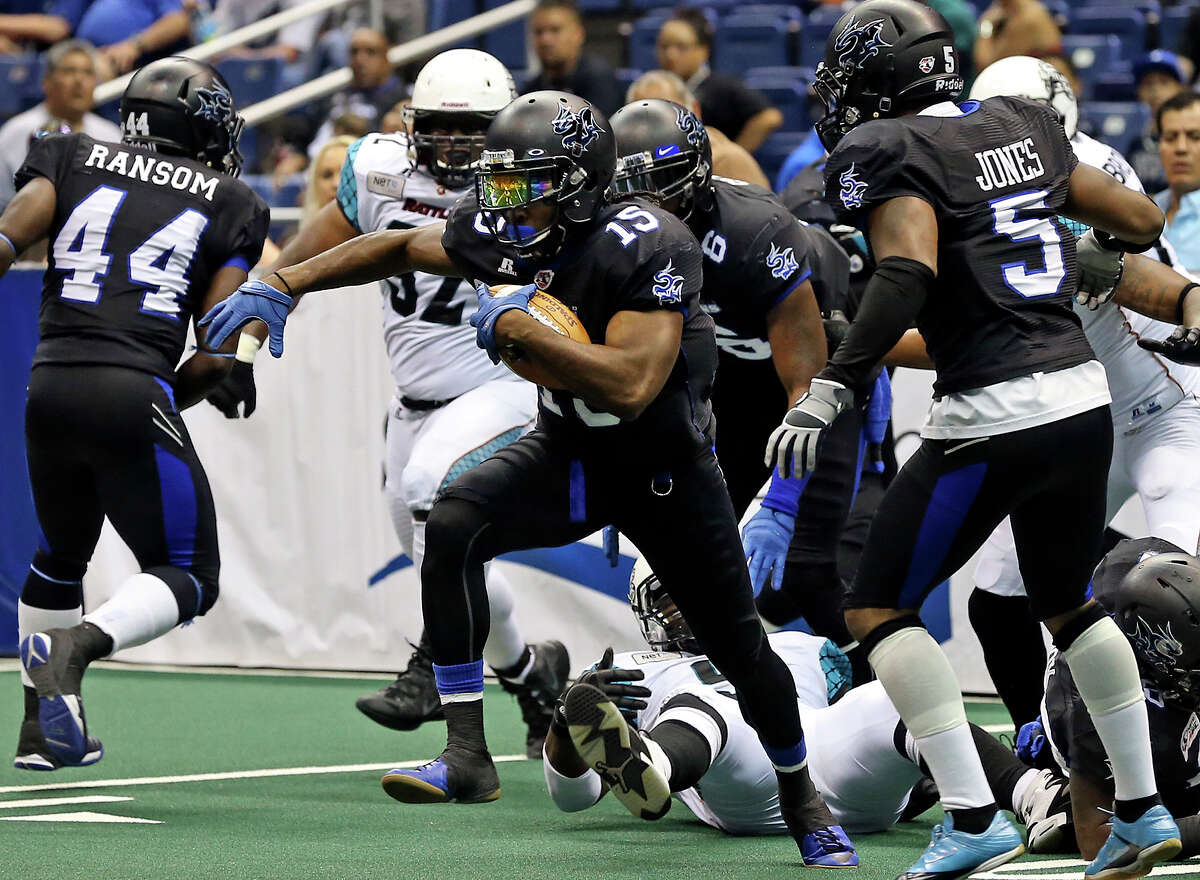San Antonio receiver Jomo Wilson escapes a heap of tacklers in the first half as the Talons host the Arizona Rattlers in the Alamodome on June 8, 2013.