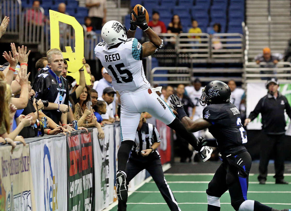 Rattler receiver Kerry Reed goes up for a reception against Carlton Brown as the Talons host the Arizona Rattlers in the Alamodome on June 8, 2013.
