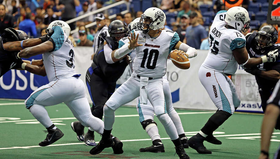Rattler quarterback Nick Davila gets protection in the pocket as the Talons host the Arizona Rattlers in the Alamodome on June 8, 2013. Photo: Tom Reel, San Antonio Express-News