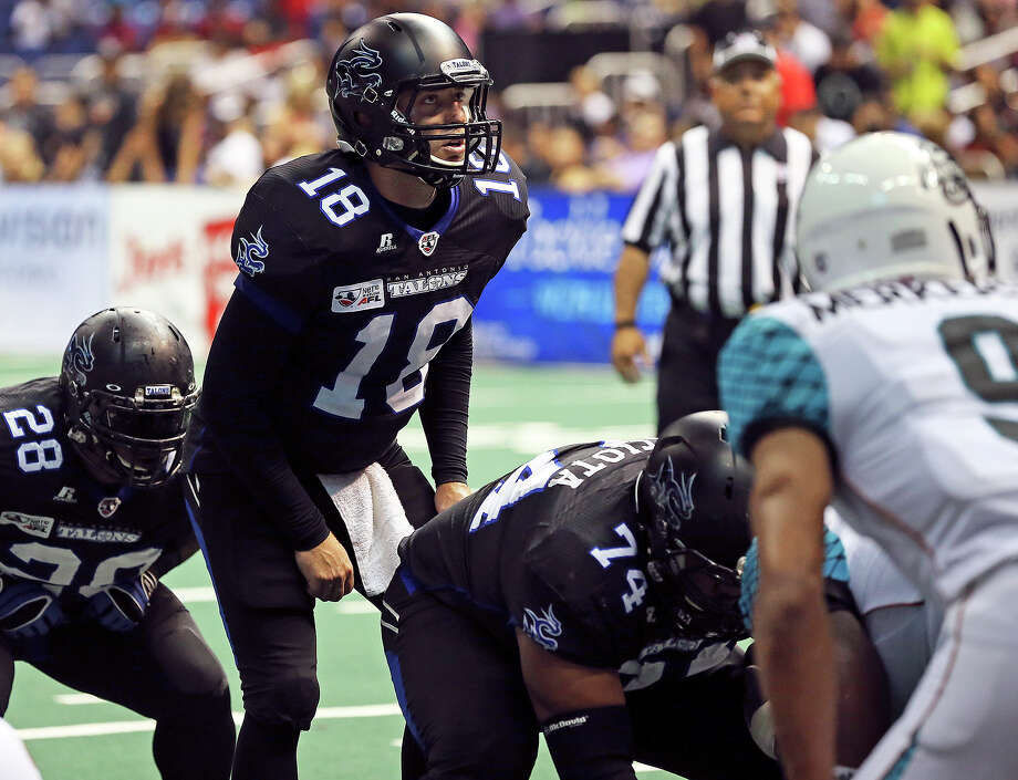 San Antonio quarterback Nick Fanuzzi runs the team in the first half as the Talons host the Arizona Rattlers in the Alamodome on June 8, 2013. Photo: Tom Reel, San Antonio Express-News
