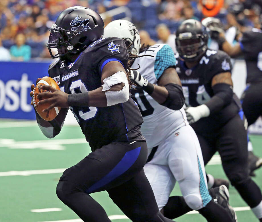 San Antonio quarterback Xavier Lee is pressured out of the backfield in the first half as the Talons host the Arizona Rattlers in the Alamodome on June 8, 2013. Photo: Tom Reel, San Antonio Express-News