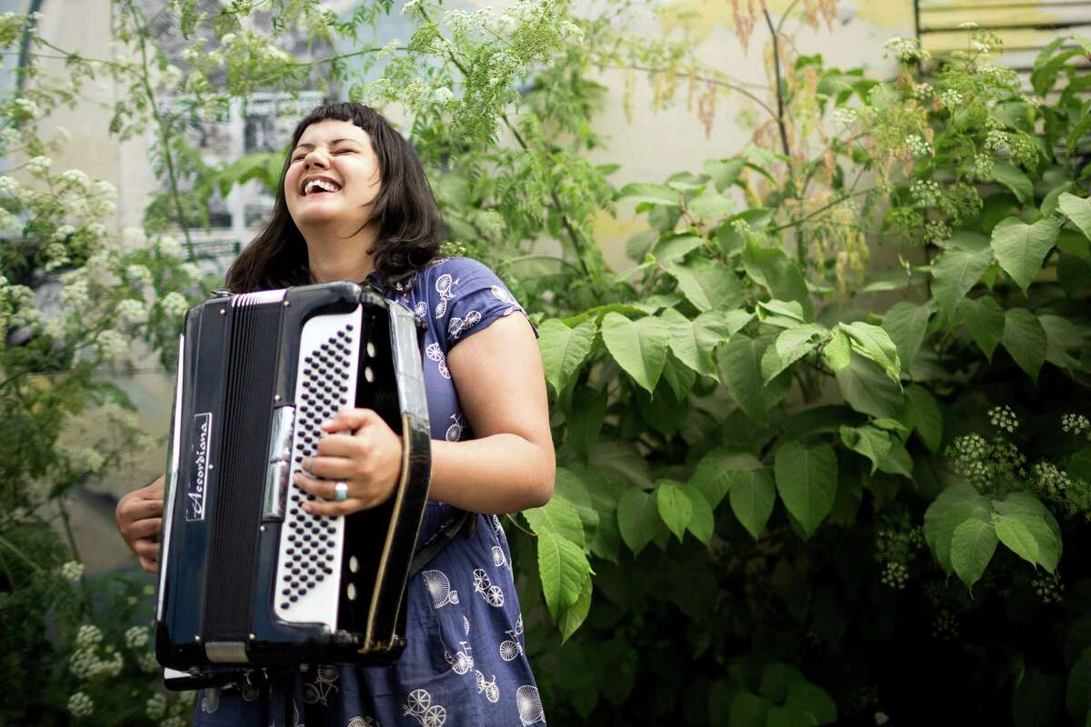 Nichole VonLudke plays her accordion for passerbys at the annual Georgetown Carnival Saturday, June 8, 2013, in the Georgetown neighborhood of Seattle. The quirky event featured live music, burlesque and crafting.