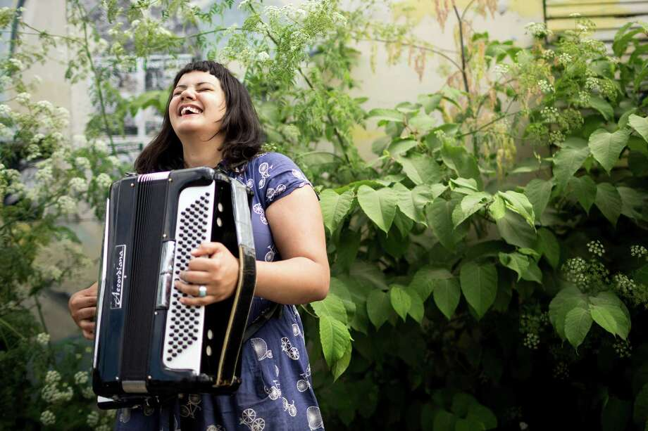 Nichole VonLudke plays her accordion for passerbys at the annual Georgetown Carnival Saturday, June 8, 2013, in the Georgetown neighborhood of Seattle. The quirky event featured live music, burlesque and crafting. Photo: JORDAN STEAD, SEATTLEPI.COM / SEATTLEPI.COM