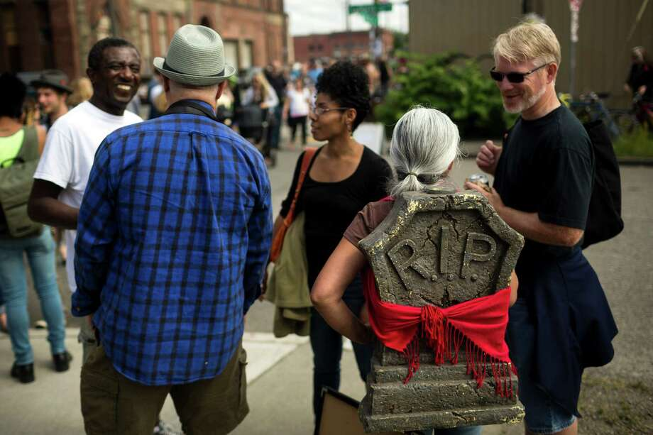 Amongst a number of costumes festival-wide, one woman sported a tombstone on her back at the annual Georgetown Carnival Saturday, June 8, 2013, in the Georgetown neighborhood of Seattle. The quirky event featured live music, burlesque and crafting. Photo: JORDAN STEAD, SEATTLEPI.COM / SEATTLEPI.COM