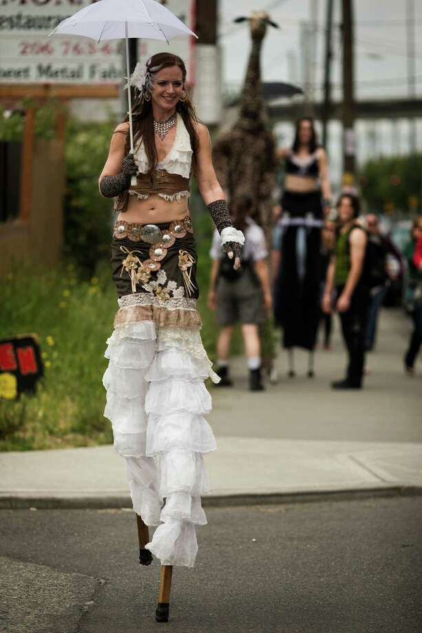 A long-legged attendee makes her way down Airport Way at the annual Georgetown Carnival Saturday, June 8, 2013, in the Georgetown neighborhood of Seattle. The quirky event featured live music, burlesque and crafting. Photo: JORDAN STEAD, SEATTLEPI.COM / SEATTLEPI.COM