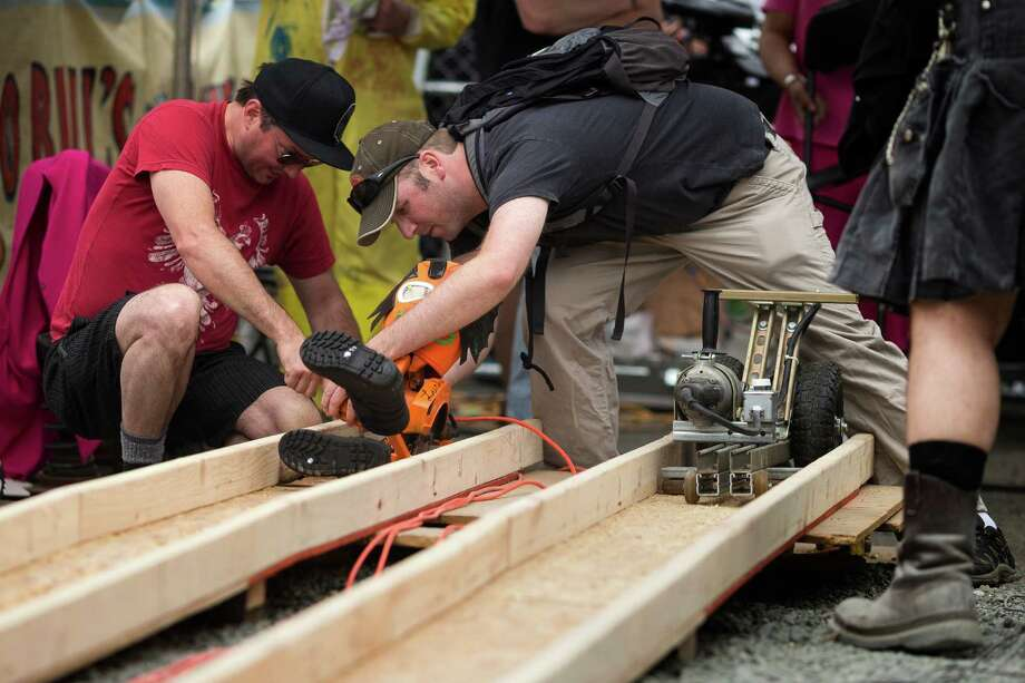 Teams prep their power tool racers during the annual Georgetown Carnival Saturday, June 8, 2013, in the Georgetown neighborhood of Seattle. The quirky event featured live music, burlesque and crafting. Photo: JORDAN STEAD, SEATTLEPI.COM / SEATTLEPI.COM