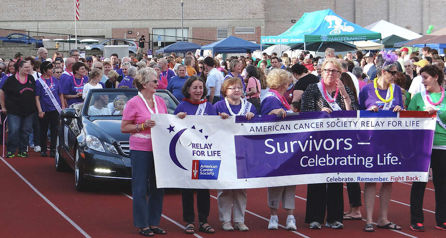 Cancer survivors take a lap around the track at Fairfield Ludlowe High School at the Relay for Life fundraiser for the American Cancer Society on Saturday evening.  FAIRFIELD CITIZEN, CT 6/8/13 Photo: Mike Lauterborn / Fairfield Citizen contributed