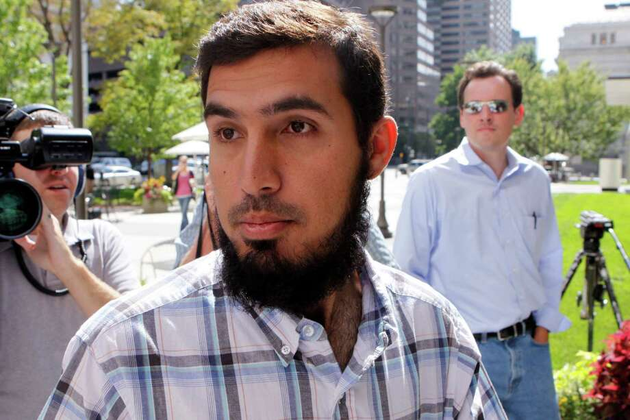 In this Sept. 17, 2009 file photo, Najibullah Zazi arrives at the federal building for questioning by the FBI in Denver. As the Obama administration defended its widespread collection of phone records, a senior U.S. intelligence official said Friday that the program helped disrupt a 2009 plot to bomb the New York City subways. Zazi, an Afghan-American, pleaded guilty in the 2009 plot, saying he had been recruited by al-Qaida in Pakistan. Photo: AP