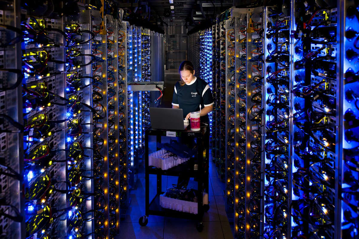 In this undated photo made available by Google, Denise Harwood diagnoses an overheated computer processor at Google's data center in The Dalles, Ore. Google uses these data centers to store email, photos, video, calendar entries and other information shared by its users. These centers also process the hundreds of millions of searches that Internet users make on Google each day.
