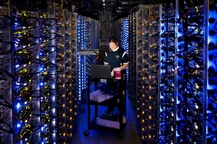 In this undated photo made available by Google, Denise Harwood diagnoses an overheated computer processor at Google's data center in The Dalles, Ore. Google uses these data centers to store email, photos, video, calendar entries and other information shared by its users. These centers also process the hundreds of millions of searches that Internet users make on Google each day. Photo: AP