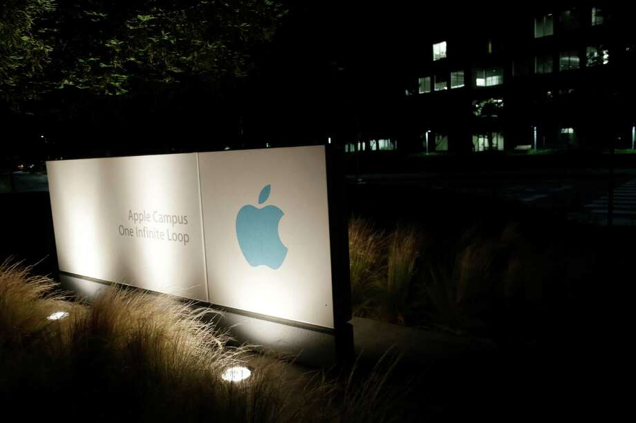 A sign displays the Apple logo outside of the company's headquarters in Cupertino, Calif., Friday, June 7, 2013. A leaked document has laid bare the monumental scope of the government's surveillance of Americans' phone records - hundreds of millions of calls - in the first hard evidence of a massive data collection program aimed at combating terrorism under powers granted by Congress after the 9/11 attacks.The companies include Microsoft, Yahoo, Google, Facebook, PalTalk, AOL, Skype, YouTube and Apple. Photo: AP