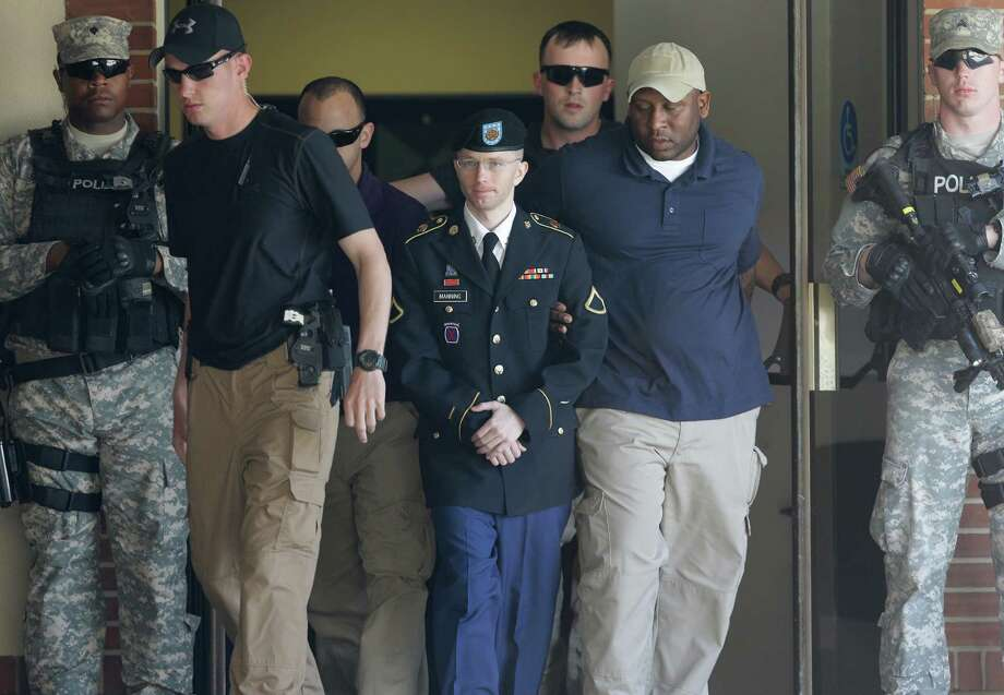 Army Pfc. Bradley Manning, center, is escorted out of a courthouse in Fort Meade, Md., Tuesday, June 4, 2013, after the second day of his court martial. Manning is charged with indirectly aiding the enemy by sending troves of classified material to WikiLeaks. He faces up to life in prison. Photo: AP
