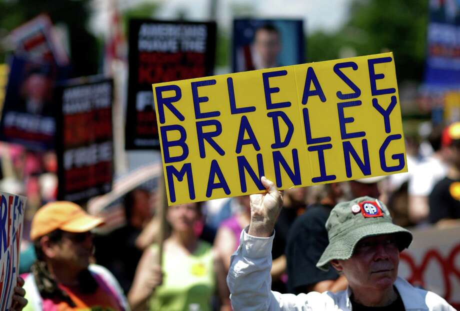 Protesters march during a rally in support of Army Pfc. Bradley Manning outside of Fort Meade, Md., Saturday, June 1, 2013. Manning, who is scheduled to face a court martial beginning June 3, is accused of sending hundreds of thousands of classified records to WikiLeaks while working as an intelligence analyst in Baghdad. Photo: AP