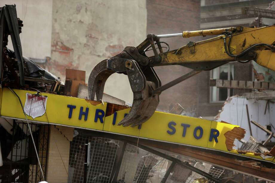 A Salvation Army Thrift store is demolished in the aftermath of a building collapse, Thursday, June 6, 2013, in Philadelphia. On Wednesday, the building under demolition collapsed onto a neighboring thrift store, killing six people and injuring 14, including one who was pulled from the debris nearly 13 hours later. Photo: AP