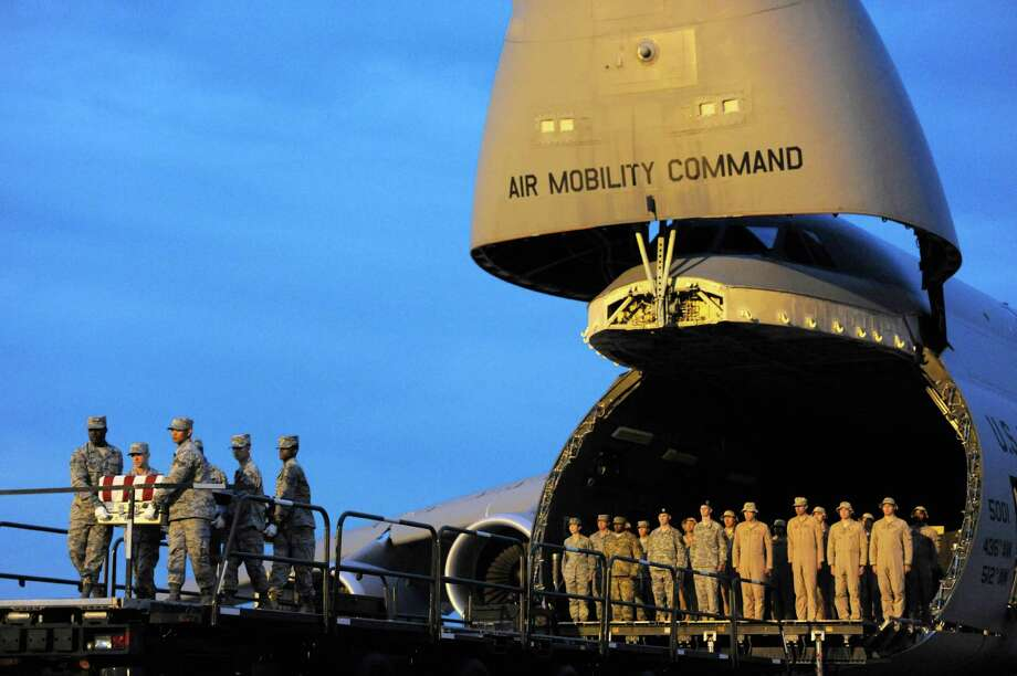 An Air Force carry team moves a transfer case containing the remains of Army Spc. Ray A. Ramirez Monday, June 3, 2013 at Dover Air Force Base, Del. According to the Department of Defense, Ramirez, 20, of Sacramento, Calif., died June 1, 2013 in Wardak province, Afghanistan of injuries sustained from an improvised explosive device. Photo: AP