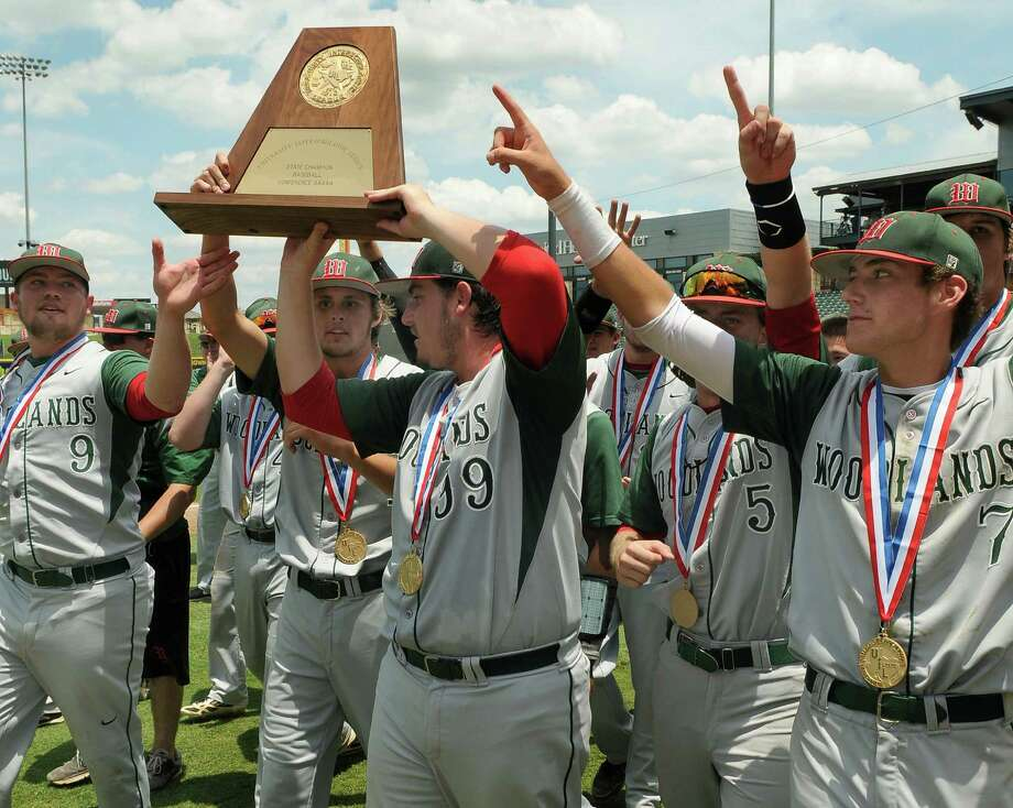 The Woodlands Highlanders, including Ryan Burnett (#9), from left, Josh Shaw (#99), Hillin Warren (#5), and Luke Shirley (#7), celebrate with their trophy after  their 9-5 over the Dulles Vikings in the 2013 Class 5A UIL Baseball State Championship game at Dell Diamond in Round Rock on Saturday. Photo: Jerry Baker, For The Chronicle