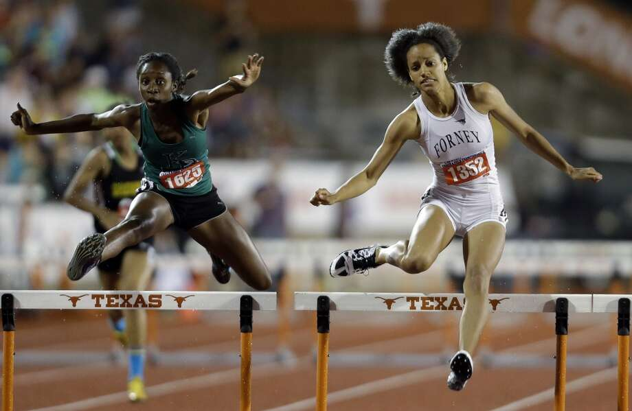 Girls hurdlesFriddaus Amadu (left), So., Kingwood Park