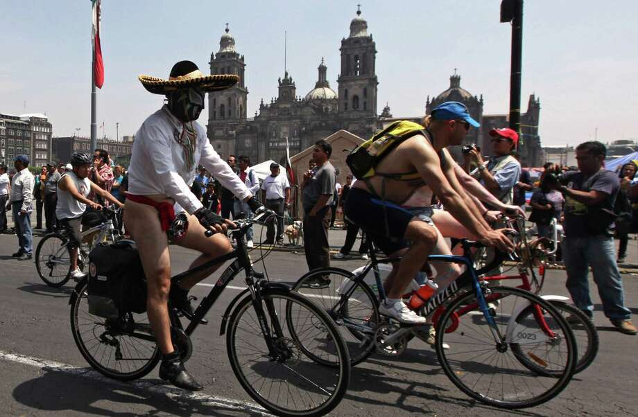 A semi-naked cyclist joins a protest ride with other bicycle enthusiasts in Mexico City, Saturday, June 8, 2013. Naked and semi-nude cyclists demonstrated to promote the use of bicycles and to highlight the damage caused by car dependency in the capital. Photo: AP