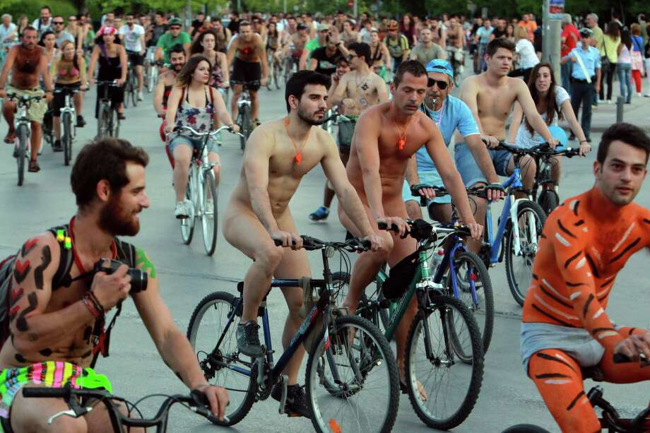 Protesters some naked with their body painted during a bicycle protest in the northern port city of Thessaloniki, Greece, on Friday, June 7, 2013. More than 1,000 people took part in the ride, many in makeup, wigs and strategically-placed accessories. The annual event, the sixth held in Thessaloniki, was meant to draw attention to the overuse of cars and to highlight the alternative joys of cycling. (AP Photo/Nikolas Giakoumidis). Photo: AP