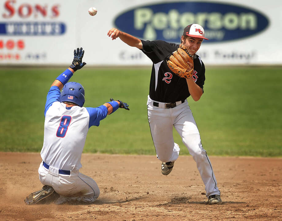 New Canaan's Matthew Toth turns a double play over Waterford baserunner Seth Hoagland in the fourth inning of New Canaan's 3-0 victory in the Class L baseball championship game at Palmer Field in Middletown, Conn. on Sunday, June 9, 2013. Photo: Brian A. Pounds / Connecticut Post