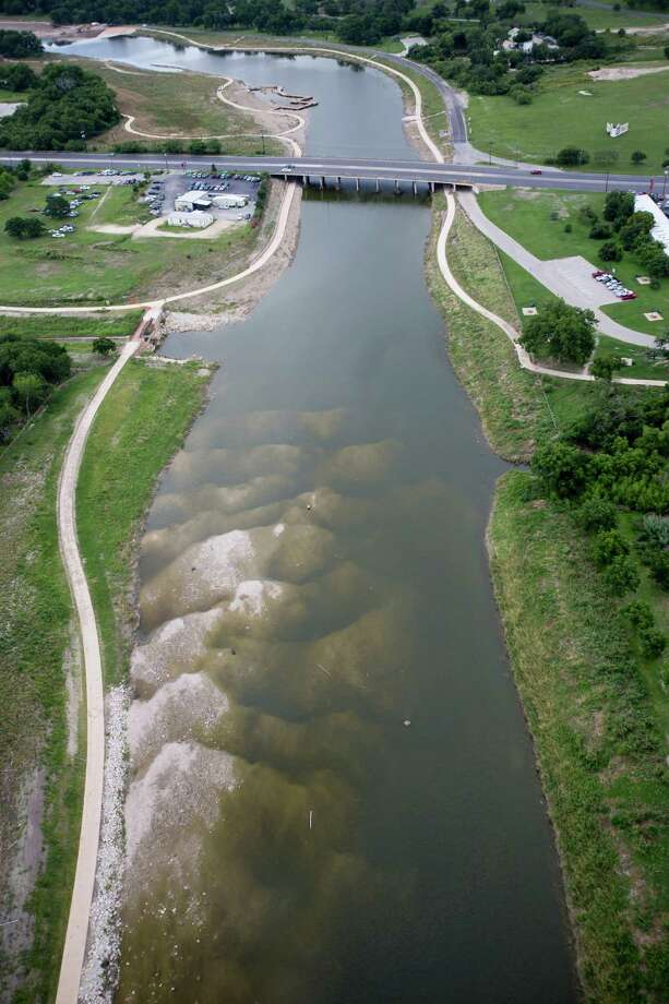 Damage from the May 25, 2013 flooding along the Mission Reach section of the San Anotnio River can be seen in this June 5, 2013 aerial picture. Photo: William Luther, San Antonio Express-News / © 2013 San Antonio Express-News