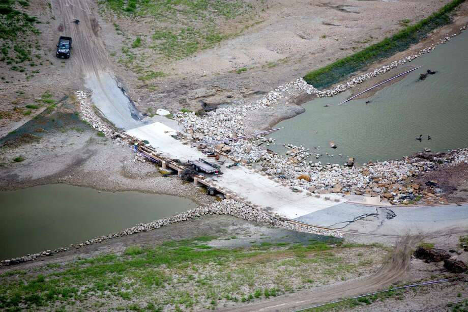 Damage to a low water crossing south of Loop 410 caused by the May 25, 2013 flooding along the Mission Reach section of the San Antonio River can be seen in this June 5, 2013 aerial picture. Photo: William Luther, San Antonio Express-News / © 2013 San Antonio Express-News
