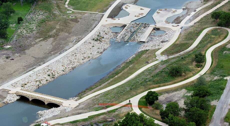 Damage from the May 25, 2013 flooding along the Mission Reach section of the San Antonio River near the canoe chute can be seen in this June 5, 2013 aerial picture. Photo: William Luther, San Antonio Express-News / © 2013 San Antonio Express-News