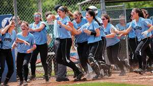 The Oxford high school team celebrates as their teammate Makena Hillman crosses home plate scoring the game winning run against Terryville high school in the CIAC class S softball championship game played at West Haven high school, West Haven, CT on Sunday June 9th, 2013.