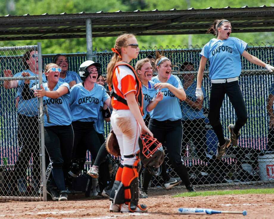 The Oxford high school team celebrate after Katelyn Wentz hit a double that drove in the game winning run during the CIAC class S softball championship game gainst Terryville high school played at West Haven high school, West Haven, CT on Sunday June 9th, 2013. Photo: Mark Conrad / Connecticut Post Freelance