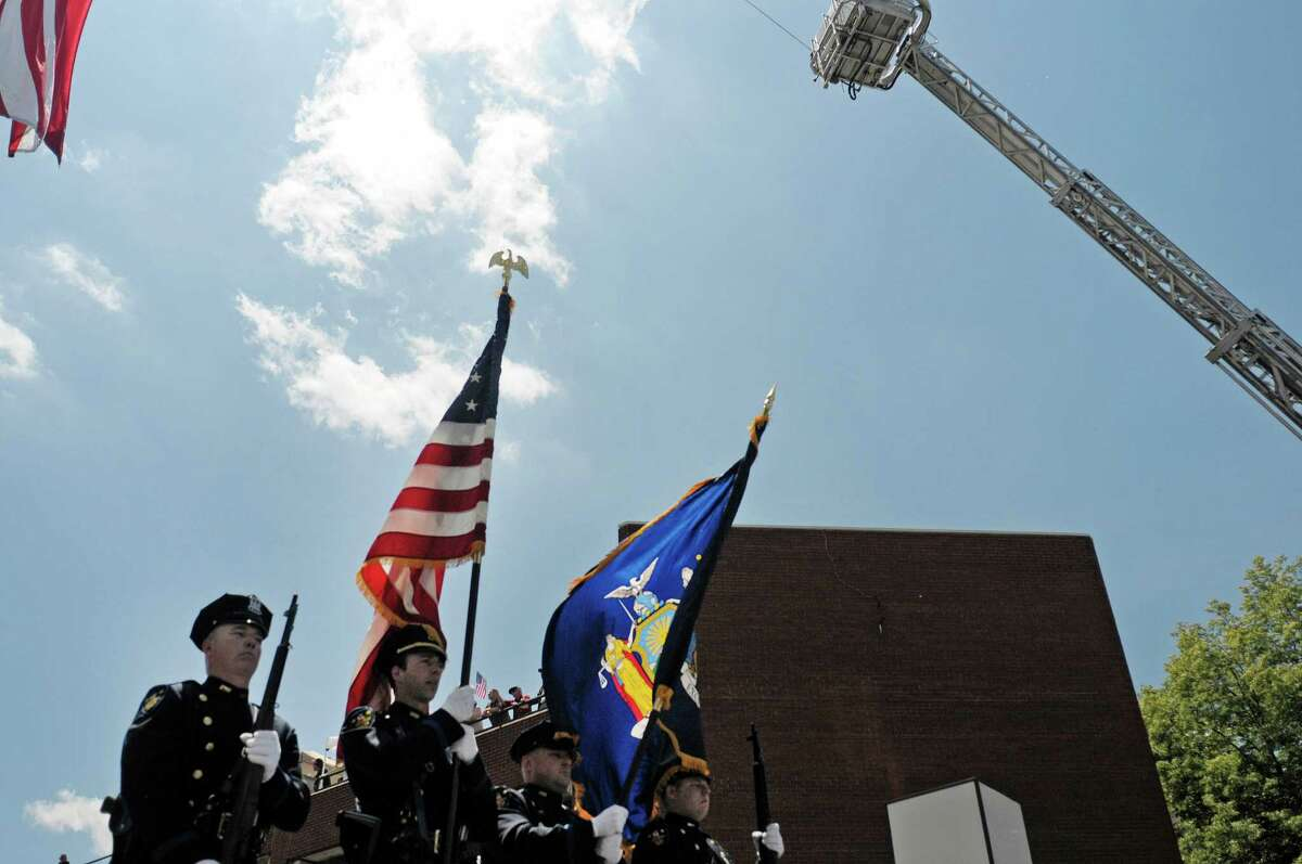 Members of the Troy Police Color Guard march in the 46th annual Flag Day Parade on Sunday, June 9, 2013 in Troy, NY. (Paul Buckowski / Times Union)