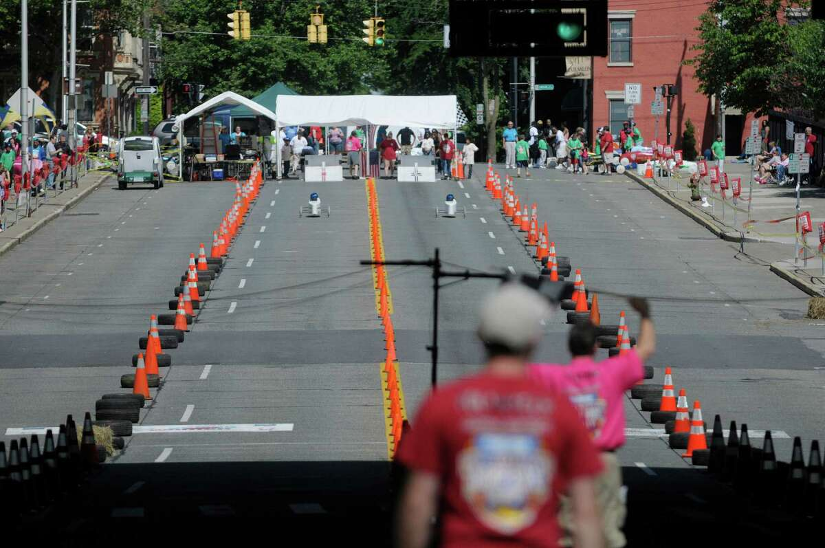 Racers head down Madison Ave. during the Capital District Soap Box Derby on Sunday, June 9, 2013 in Albany, NY. The races were held on Saturday and Sunday. (Paul Buckowski / Times Union)